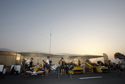 Renault F1 team members prepare the R28 cars in the early morning
