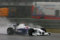 Robert Kubica, BMW Sauber F1 Team with a demolished front wing