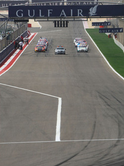The Safety Car leads the field on the formation lap