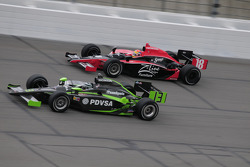 Ernesto Viso, HVM Racing and Justin Wilson, Dale Coyne Racing run together