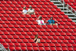 Fans bear the hot temperatures