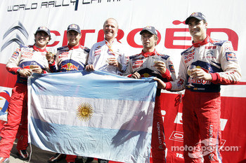 Winners Sébastien Loeb and Daniel Elena, Citroen C4, Citroen Total World Rally Team, second place Daniel Sordo and Marc Marti celebrate with Citroen Total World Rally Team boss Olivier Quesnel