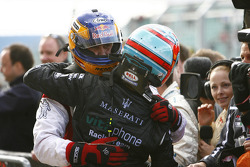 GT1 and overall winner Karl Wendlinger celebrates with Andrea Bertolini
