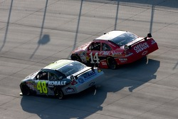 Jimmie Johnson makes a late pass on Tony Stewart