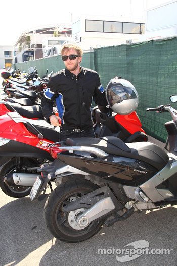 Nick Heidfeld, BMW Sauber F1 Team arrives at the circuit on a motorbike