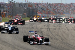 Jarno Trulli, Toyota F1 Team leads Nico Rosberg, Williams F1 Team