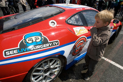 A young fan looks the #81 Advanced Engineering Team Seattle Ferrari F430 GT