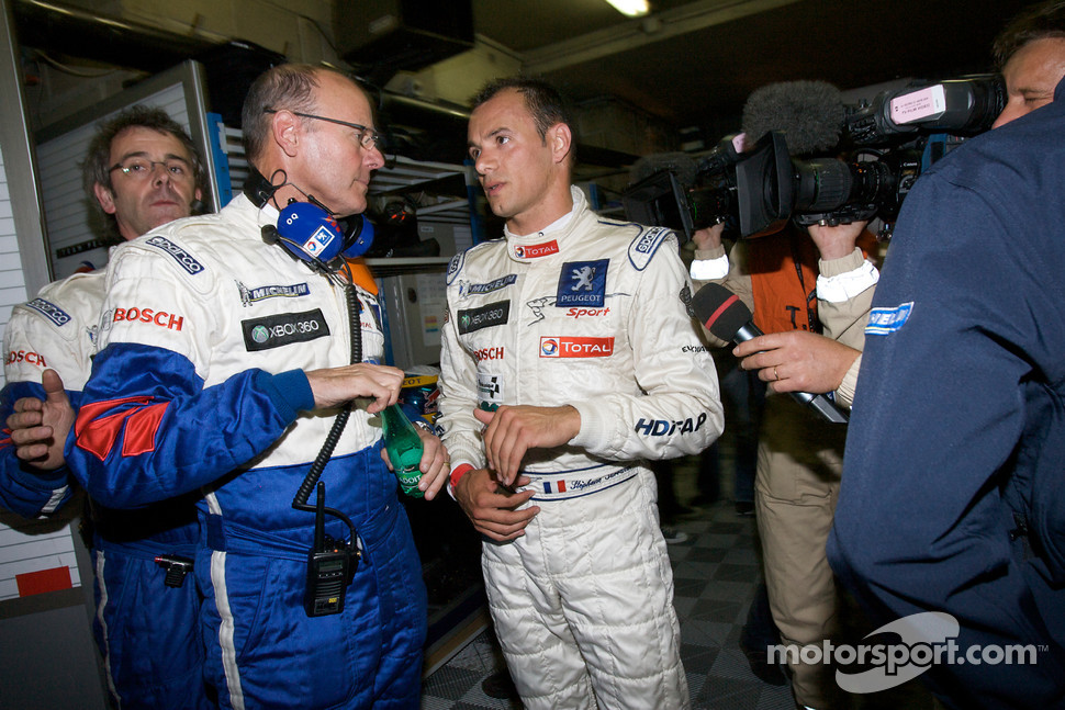 Pole winner Stéphane Sarrazin celebrates with Peugeot Sport director Olivier Quesnel