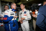 Pole winner Stphane Sarrazin celebrates with Peugeot Sport director Olivier Quesnel