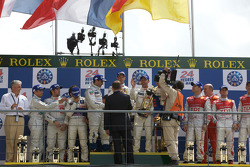 LMP1 podium: class and overall winners Alexander Wurz, David Brabham and Marc Gene, second place Stéphane Sarrazin, Franck Montagny and Sébastien Bourdais, third place Allan McNish, Rinaldo Capello and Tom Kristensen
