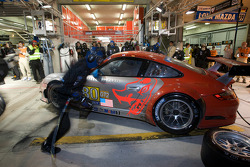 Pit stop for #80 Flying Lizard Motorsports Porsche 911 GT3 RSR: Jorg Bergmeister, Darren Law, Seith Neiman
