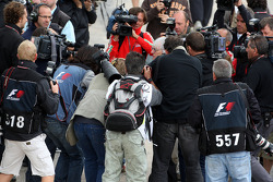 Bernie Ecclestone surrounded by photographers