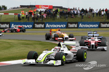 Jenson Button, Brawn GP leads Timo Glock, Toyota F1 Team