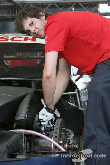 A mechanic works on car of Martin Tomczyk, Audi Sport Team Abt Audi A4 DTM