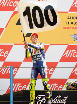 Podium: race winner Valentino Rossi, Fiat Yamaha Team celebrates 100th MotoGP win