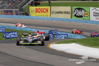 Dan Wheldon, Panther Racing leads Hideki Mutoh, Andretti Green Racing