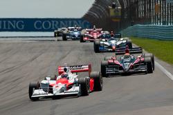 Ryan Briscoe, Team Penske leads Justin Wilson, Dale Coyne Racing