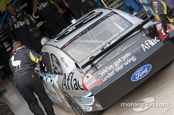 The Aflac crew push their Ford Fusion back into their garage stall