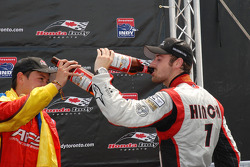 Podium: race winner Sebastian Saavedra, third place James Hinchcliffe