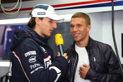 Lukas Podolski visits the garage of BMW and talks with Robert Kubica, BMW Sauber F1 Team