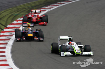 Rubens Barrichello, Brawn GPleads Sebastian Vettel, Red Bull Racing