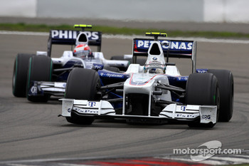 Nick Heidfeld, BMW Sauber F1 Team and Kazuki Nakajima, Williams F1 Team