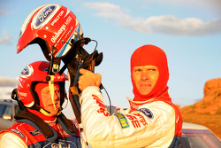 Marcus Gronholm puts on his helmet before the first practice for the Pikes Peak Hillclimb