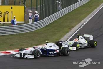 Nick Heidfeld, BMW Sauber F1 Team and Rubens Barrichello, Brawn GP