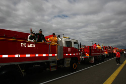 Fire trucks prepare to take drivers around the track for the driver parade