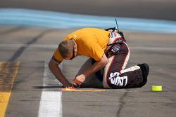 Hendrick Motorsports Chevrolet crew member prepares pit area