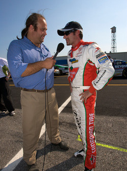 TV interview as pole winner Alex Tagliani