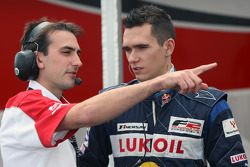 Chris Dredge Formula Two Championship Co-ordinator talks with Mikhail Aleshin