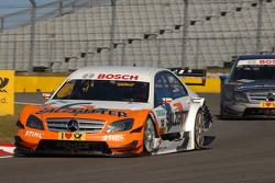 Gary Paffett, Team HWA AMG Mercedes AMG Mercedes C-Klasse leads Bruno Spengler, Team HWA AMG Mercedes AMG Mercedes C-Klasse