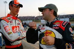 Joey Logano, driver of the #20 Home Depot car speaks with Tony Stewart, driver of the #14 Bass Pro Shops Chevrolet