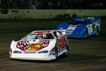 Tony Stewart, driver of the #14 Bass Pro Shops Chevrolet leads Red Farmer, driver of the #97