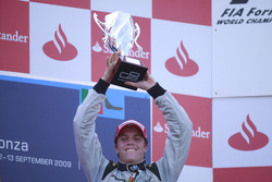 Luiz Razia celebrates his victory on the podium