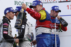 LMP1 podium: class and overall winners Olivier Panis and Nicolas Lapierre celebrate with champagne