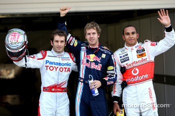 Jarno Trulli, Toyota F1 Team 2nd, Sebastian Vettel, Red Bull Racing in pole position, Lewis Hamilton, McLaren Mercedes 3rd