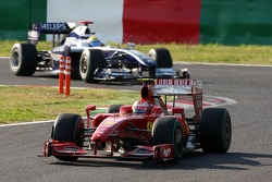 Kimi Raikkonen, Scuderia Ferrari leads Nico Rosberg, WilliamsF1 Team