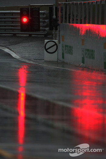 The session is flagged flagged and starts late due to rain