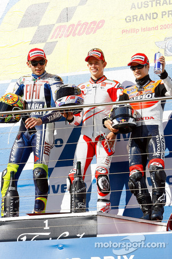 Podium: race winner Casey Stoner, Ducati Marlboro Team, second place Valentino Rossi, Fiat Yamaha Team, third place Dani Pedrosa, Repsol Honda Team