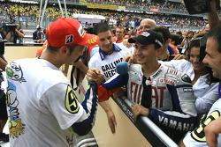 2009 MotoGP champion Valentino Rossi, Fiat Yamaha Team celebrates with Jorge Lorenzo