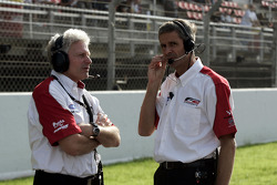 Giles Butterfield Formula Two Group Operations Manager talks with an F2 engineer