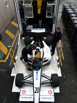 F2 Mechanics load the car of Jens Hoing into the trucks
