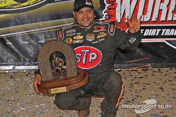 Donny Schatz holds up four fingers in testimony to his four World of Outlaws Sprint Car Series championships