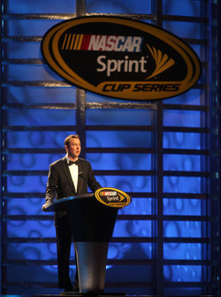 Kurt Busch accepts his award for fourth place in the Chase for the NASCAR Sprint Cup