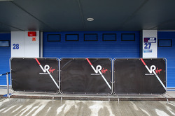Screens in front of a closed Virgin Racing Garage