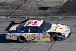 John Andretti, Front Row Motorsports with Yates Racing Ford in the pit with damage