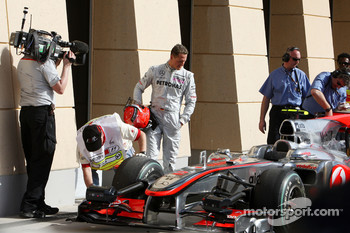 Michael Schumacher, Mercedes GP, looks at the Mclaren