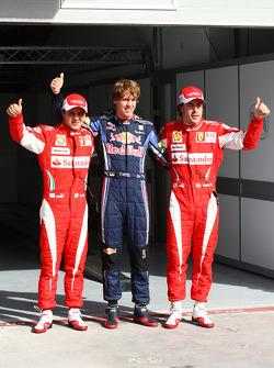 Pole winner Sebastian Vettel, Red Bull Racing, with second place Felipe Massa, Scuderia Ferrari and third place Fernando Alonso, Scuderia Ferrari